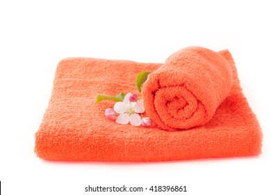 Two orange towels with apple flower on white background