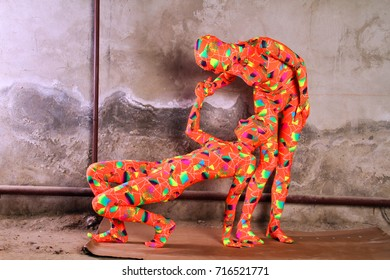 two orange zentai girls