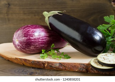 Two organic fresh eggplants on wooden background close up