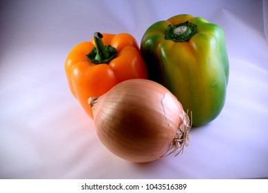 Two organic sweet peppers and an onion
