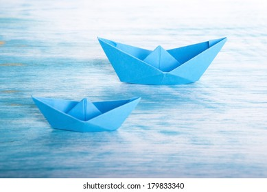 Two Origami Boats in the Sea