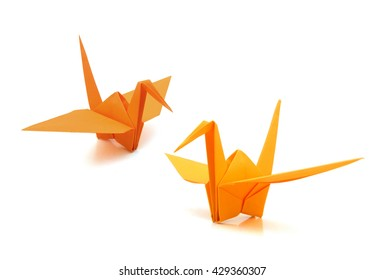 two origami cranes on white background