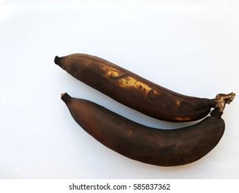 Two overripe banana on white background.