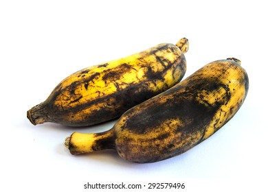 Two over-ripenned bananas, isolated on white background.