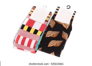 Two pack of three pair of socks with a tag isolated on a white background