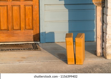 Two Packages await you on your doorstep. Package delivery , cardboard boxes left on patio doorstep with door matte