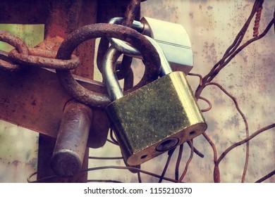 Two padlocks with chain