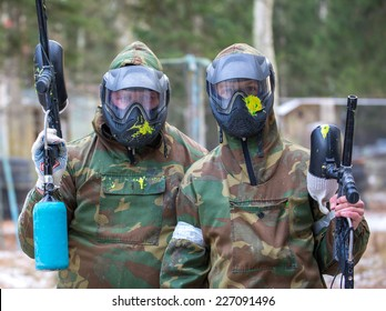 Two paintball players with headshots