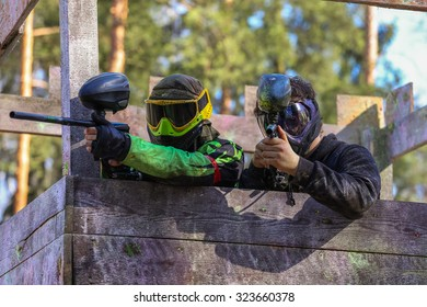 Two paintball shooters defending wooden tower