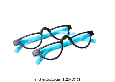 Two pair of black and blue spectacles isolated on white background