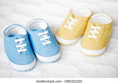 two pairs of baby shoes, small sneakers