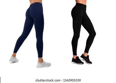 Two pairs beautiful slim female legs in blue and black sport leggings and running shoes isolated on white background. Concept of stylish clothes, sports, beauty, fashion and slim legs