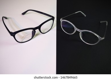 Two pairs of contrasting glasses appear to be in conversation.