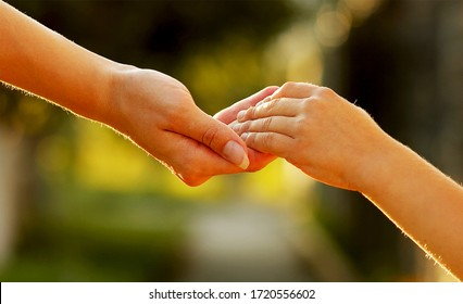 Two pairs of hand touching each other, helping hands
