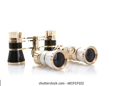 Two Pairs of opera glasses on a white background with reflection