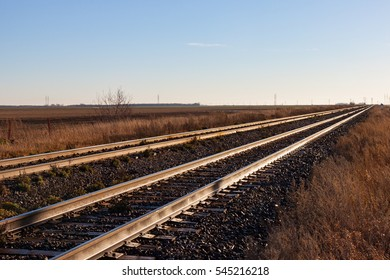 Two Pairs of Tracks Stretching Off toward the Horizon