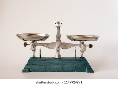 Two pan tray balance weight scale on white background.