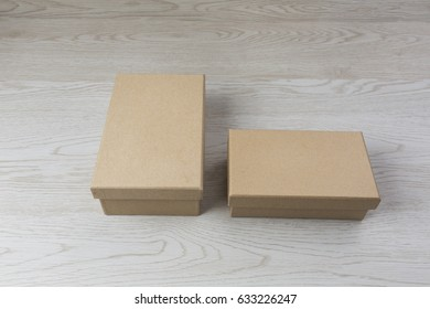Two Paper box on white wooden background