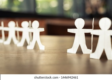 Two paper human chains disconnect or loosing doll in a role of team, teamwork or connection concept
