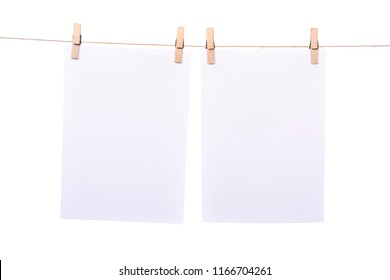 Two paper sheet hanging on rope isolated over white background