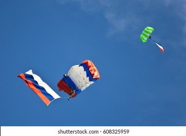 Two parachutists gliding with russian flags