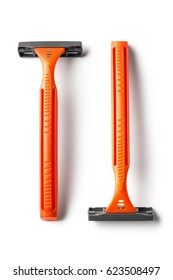 Two parallel orange shavers, isolated on white background