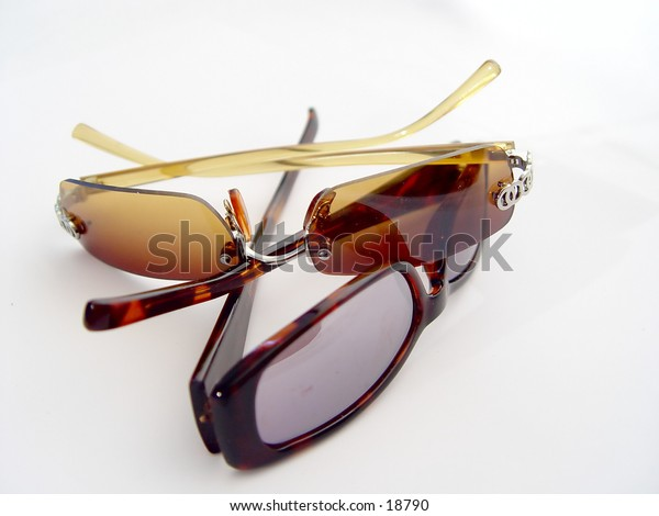 Two Paris of Sunglasses isolate don white background