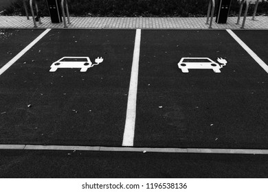 Two parking spaces for electric cars in black and white