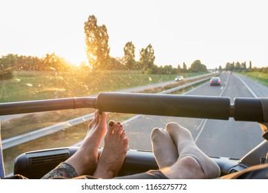 two passengers enjoy a bus ride