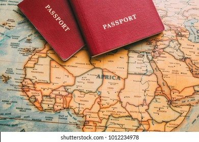 Two passports on map. Travel to Africa