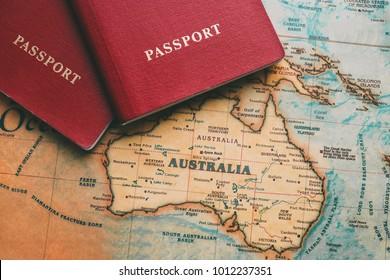 Two passports on map. Travel to Australia