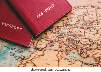 Two passports on map. Travel to Europe