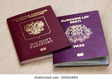 two passports on the table. dual citizenship of Estonia and russia, europe