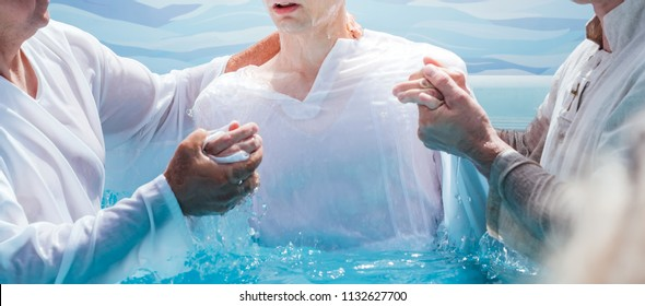 Two pastors baptize man