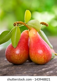 Two pears on the wooden table