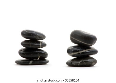 Two pebble pyramids over white background