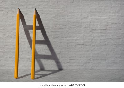 Two pencils and a shadow in form of ladder near the stone wall. Success, teamwork and solving problems business concept. Copy space for text .