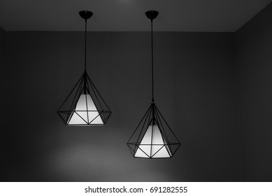 Two pendant lamps hanging on ceiling. Contemporary Design in black and white shade.