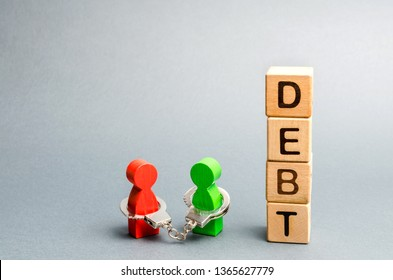 Two people are bound by handcuffs with the word Debt. Creditor and debtor. Financial slavery. Unclosed commitments. Blackmail and illegal pursuit. Psychological pressure. Debts relief. Debt pit.