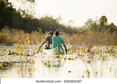 Two people canoeing in natural setting
