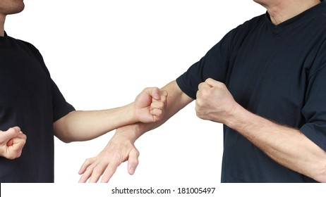 Two people are doing techniques Wing Chun