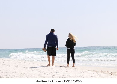 two people enjoying their vacation in the beach