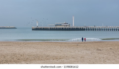 Two people enjoying a view on Oostende beach
