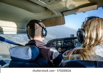 two people flying a plane