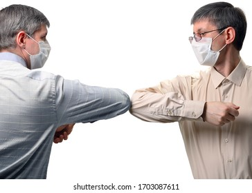 Two people greet elbows bump. New style of greeting during the spread of coronavirus. Isolated on a white background