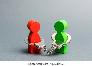 Two people are handcuffed to each other. Unclosed obligations between two persons, financial or moral debt. Contract, duty, responsibility and duty. Keep the word, keep the promise.