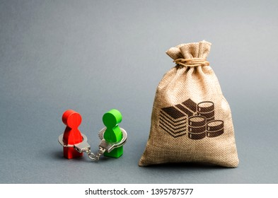 Two people are handcuffed to each other and stand near a money bag. Unclosed obligations between two persons, financial or moral debt. refusal to return debts. redemption and restructuring.