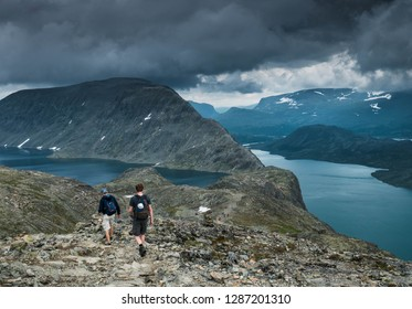 Two people hiking the famous besseggen trail in Jotunheimen National Park, Norway