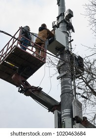 Two people install equipment on a cell tower. Moscow, Russia - April 2016