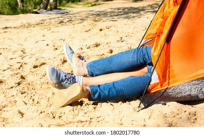 Two people lie in a tourist tent. Young couple having sex in tent. Tourist camp